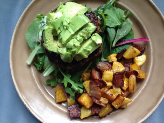 Spicy burger with bacon, plantains, spinach, avocado