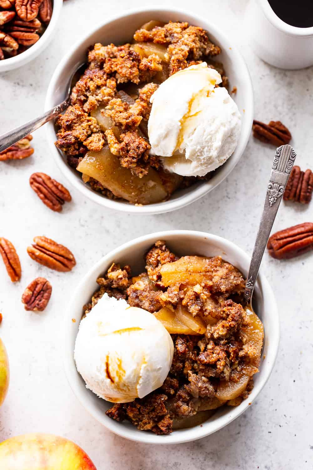 A healthy version of a classic fall dessert, this Paleo Maple Pecan Apple Crisp is the perfect warm and sweet comfort food on cozy nights. It's grain free, gluten free, paleo, vegan, and soy free with simple whole ingredients and the fall flavors you crave. #paleo #vegan #cleaneating #applecrisp #healthybaking