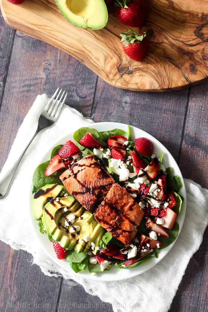 salmon avocado strawberry salad with maple balsamic reduction and goat cheese