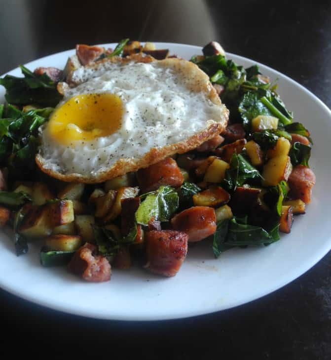 Sweet potatoes, andouille sausage and collards