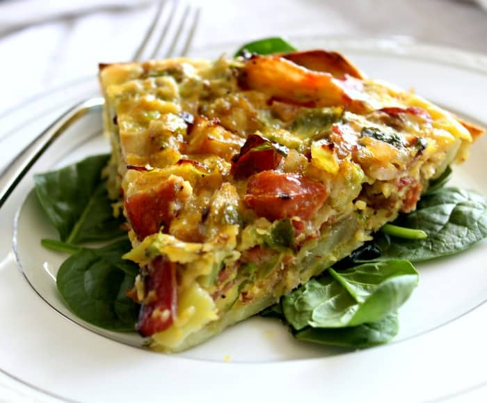 Sweet Potato Crusted Quiche with bacon, brussels, and sausage