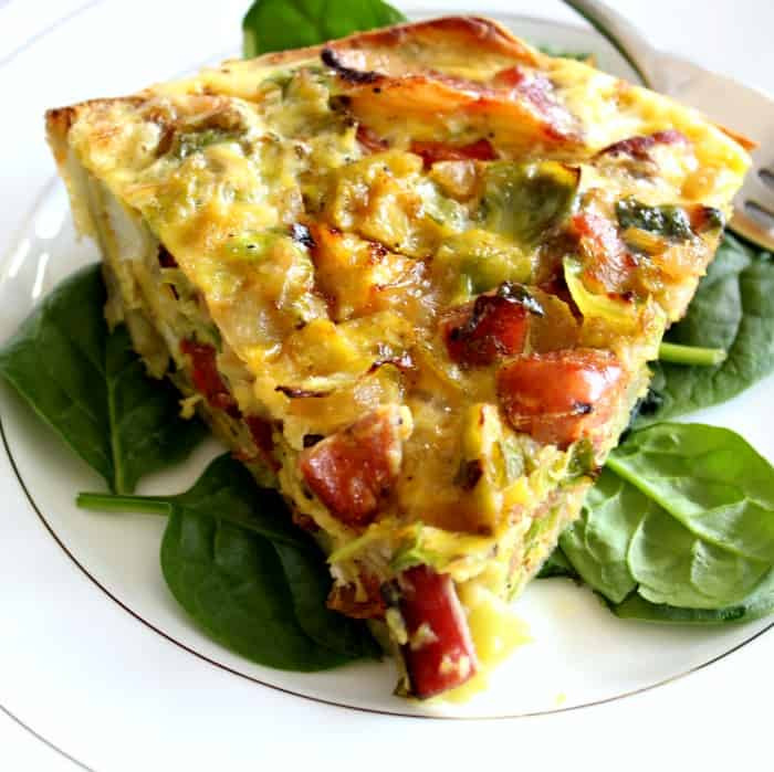 Sweet Potato Crusted Quiche with bacon, brussels, sausage