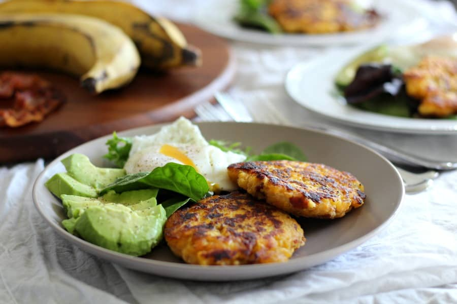 Plantain bacon fritters with avocado and poached egg
