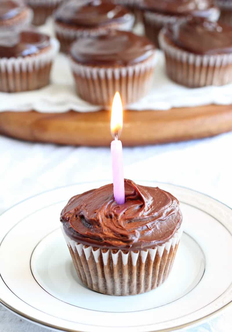 vanilla cupcake with candle and chocolate