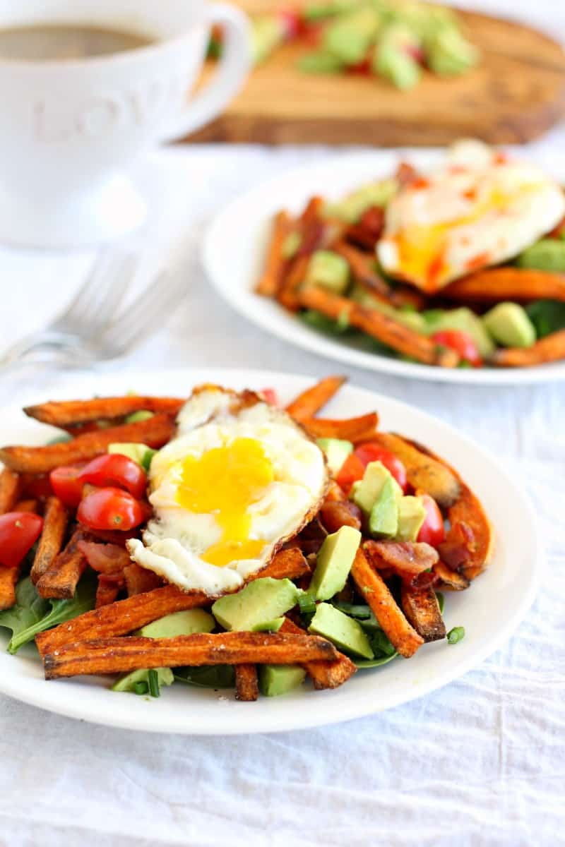 smothered breakfast sweet potato fries with eggs and avocado