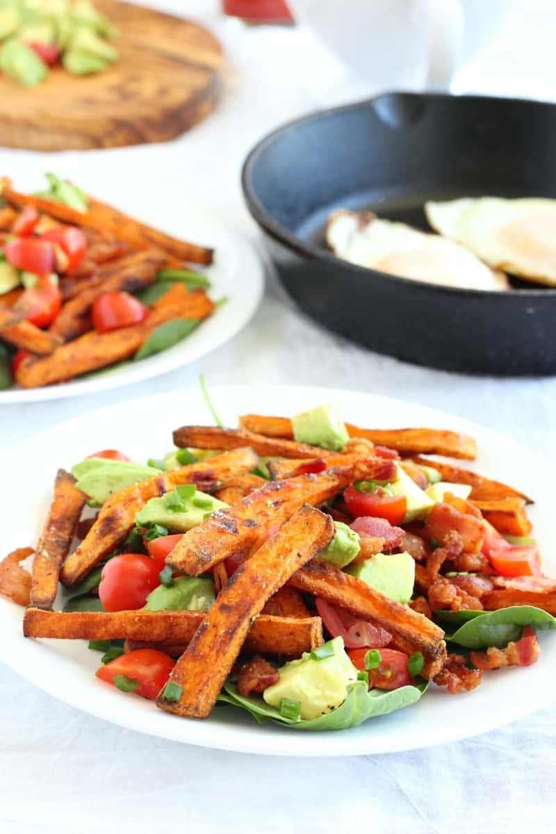 smothered paleo breakfast sweet potato fries with fried eggs