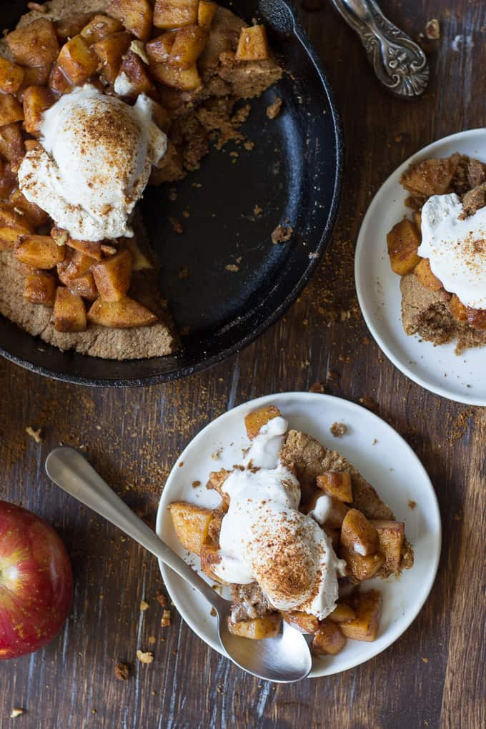 apple pie snickerdoodle skillet with two servings portioned on white plates