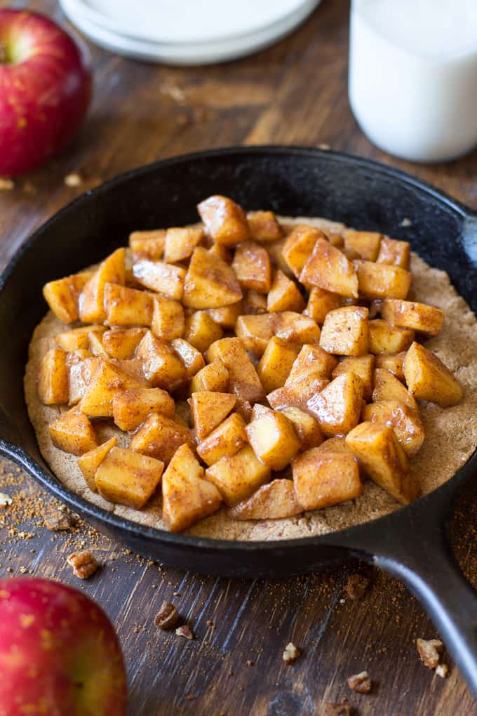 apple pie snickerdoodle skillet cookie in a cast iron skillet