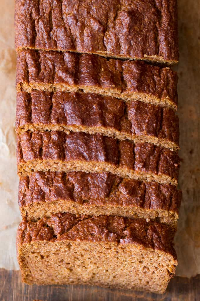 a loaf of baked Paleo pumpkin bread cut into slices