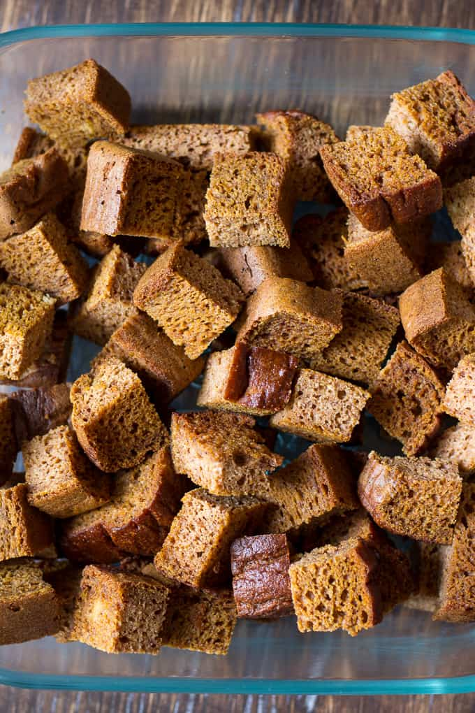 cubes of grain free pumpkin bread in a glass baking dish