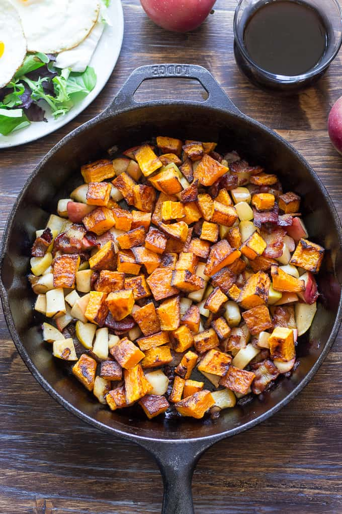 baked diced butternut squash, apples, and bacon in a skillet