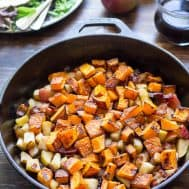 butternut squash and bacon apple hash in an iron skillet