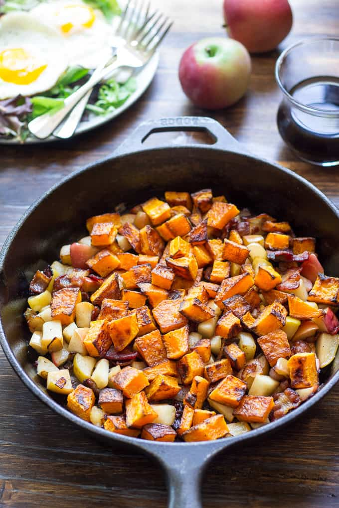 butternut squash hash with bacon and apples in a cast iron skillet