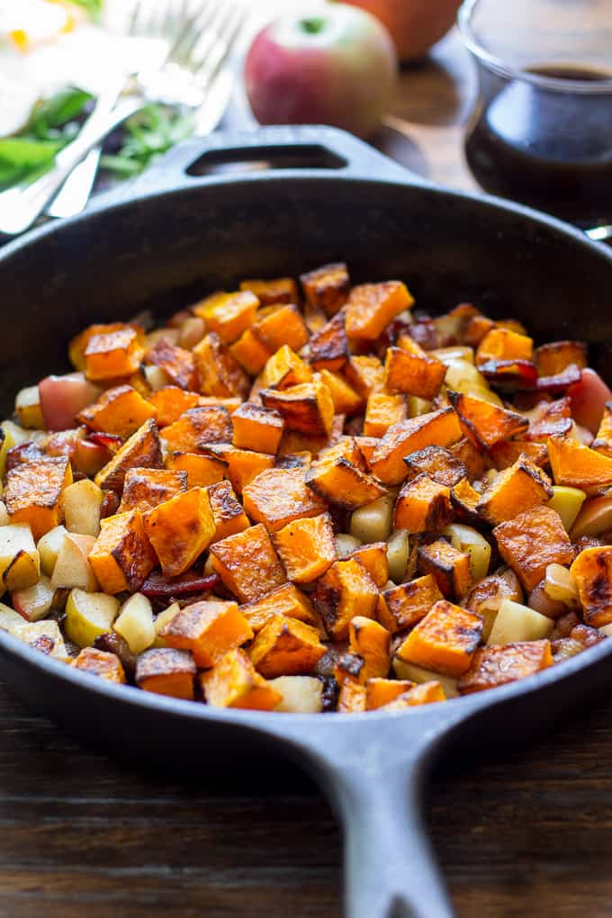 closeup photo of butternut squash and apple hash in a skillet