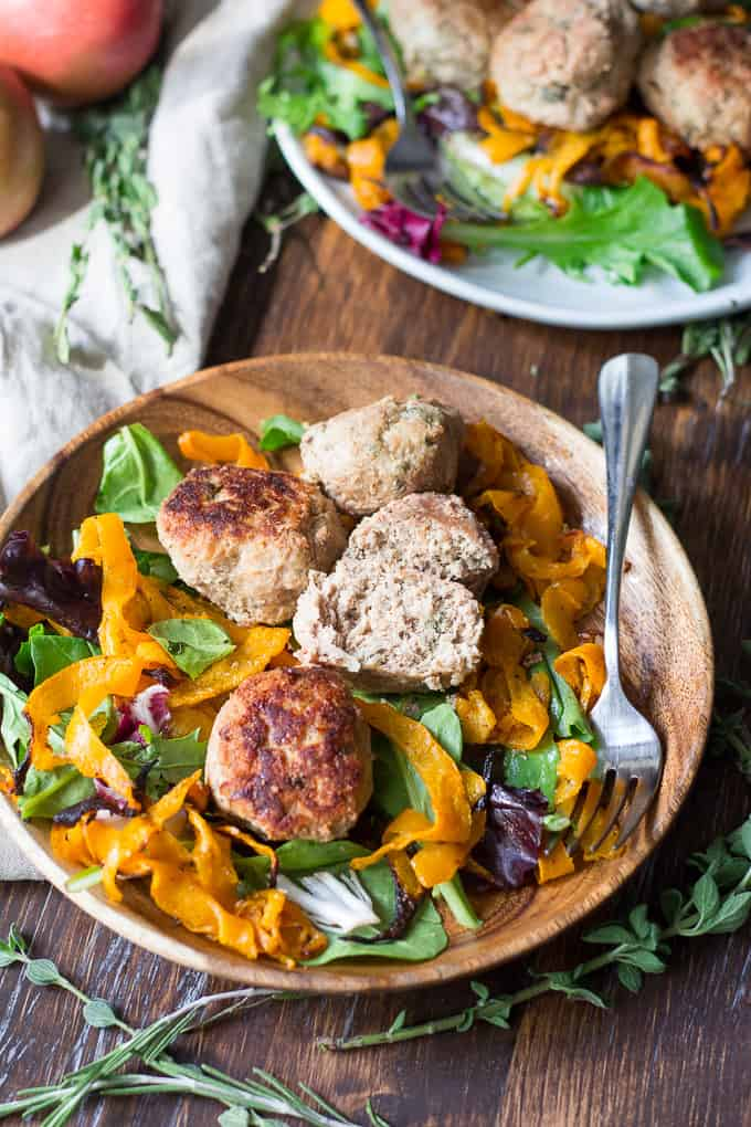 turkey meatballs and salad in a wooden bowl on a wooden board