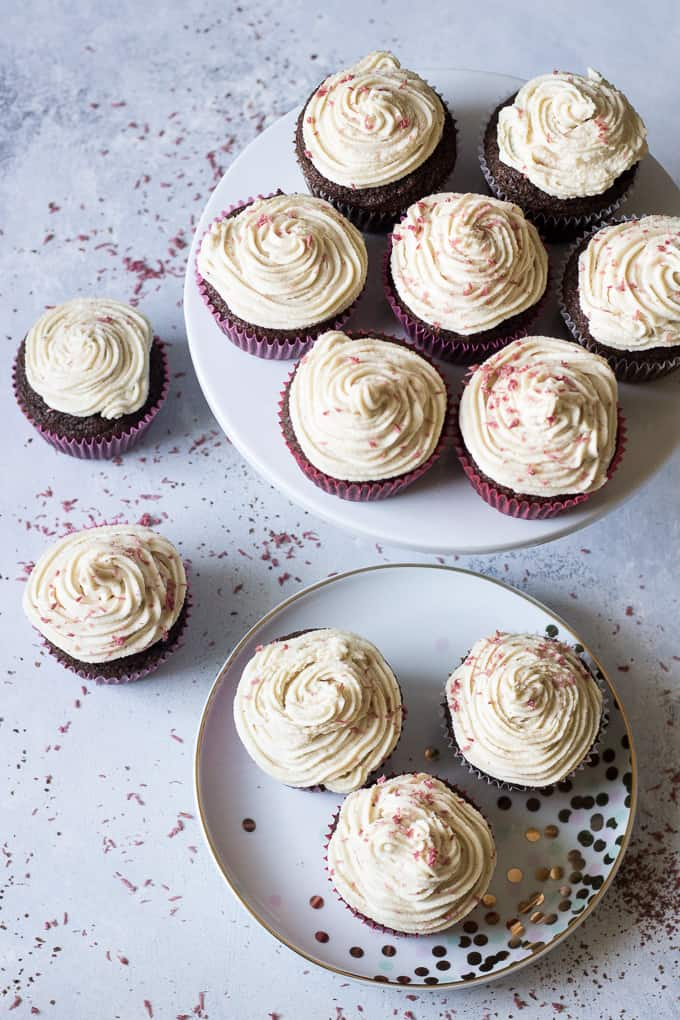 "Perfect Paleo Chocolate Cupcakes (grain free, dairy free, soy free) made with coconut flour, topped with homemade coconut cashew ""cream cheese"" frosting and pink coconut sprinkles!"