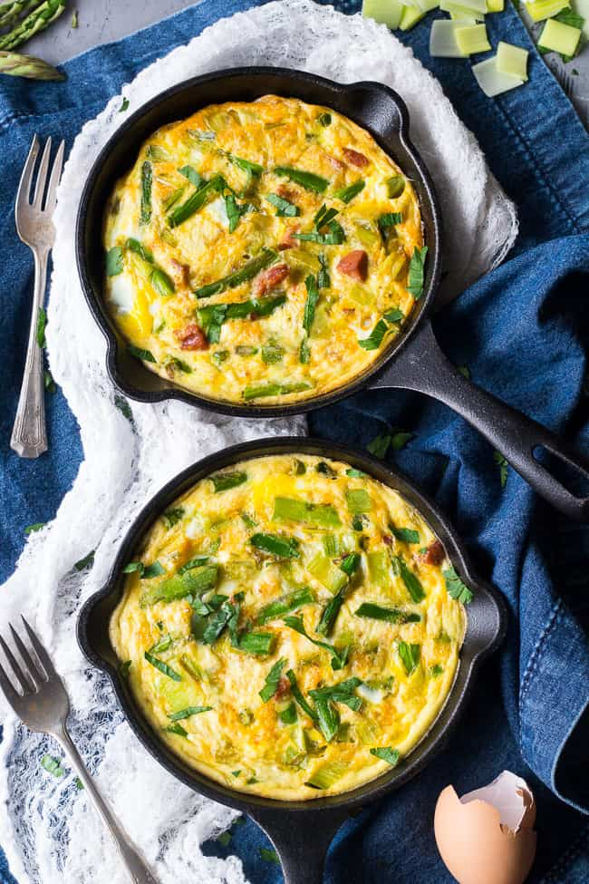 "This easy, healthy asparagus frittata with spicy sausage and leeks is perfect for breakfast, brunch, or ""brinnner"" during the spring and summer months!  It's Paleo and Whole30 friendly, low carb, and ready in 30 minutes.  Perfect for breakfast, brunch, or breakfast for dinner!"