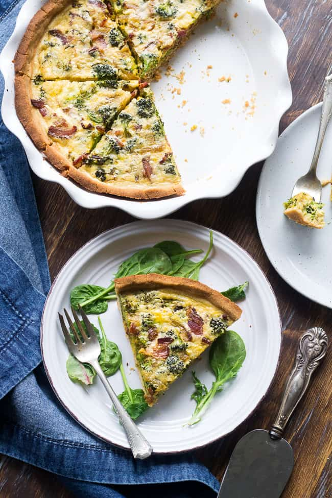 "This Paleo broccoli quiche is easy to make and perfect as a make ahead breakfast or to bring to brunch for Easter, Mother's Day or anything else! It's loaded with caramelized onions, savory sautéed broccoli and crisp bacon, plus has a secret ""cheesy"" ingredient while remaining dairy free! Grain free, gluten free, healthy."