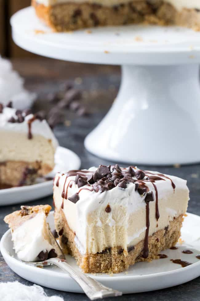 This chocolate chip cookie vanilla cheesecake starts with a thick vegan chocolate chip cookie layer topped with creamy cashew vanilla cheesecake, coconut whipped cream, more chocolate chips and a rich drizzle of chocolate. It's the perfect secretly healthy dessert for any special occasion, holiday, or simply because you want to treat yourself! Gluten free, dairy free, vegan, paleo.