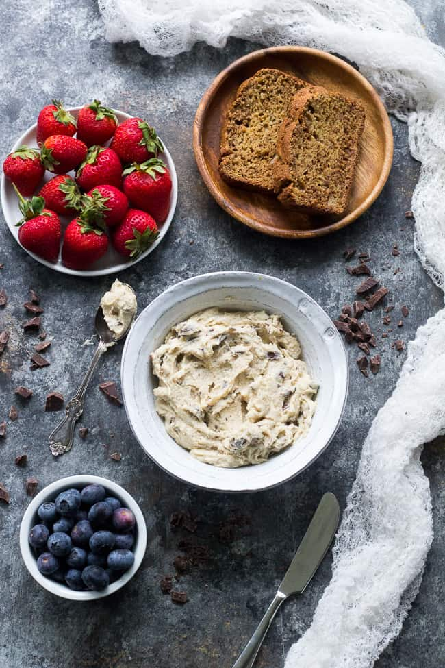 This super quick and easy cashew-based chocolate chip cheesecake dip (or spread!) is perfect for healthy sweet snacks and desserts. No need to make a whole cheesecake when a craving hits! This versatile dip/spread is dairy-free, paleo, vegan, and loaded with creamy texture and dark chocolate.
