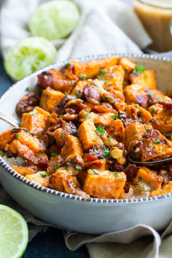 This roasted sweet potato salad is packed with crispy bacon, toasted walnuts, and tossed in a date-sweetened lime vinaigrette. Paleo and Whole30 friendly, dairy free and easy to make, it's the perfect healthy sweet and savory side dish for your picnic, barbecue, or everyday meal.