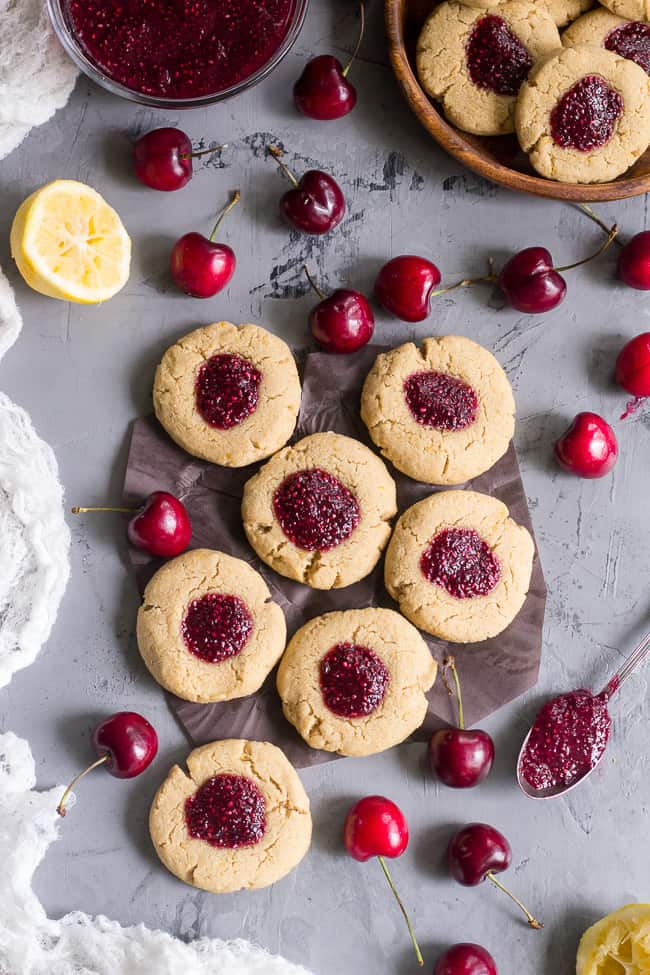 chewy lemon almond thumbprint cookies are filled with cherry chia jam ...