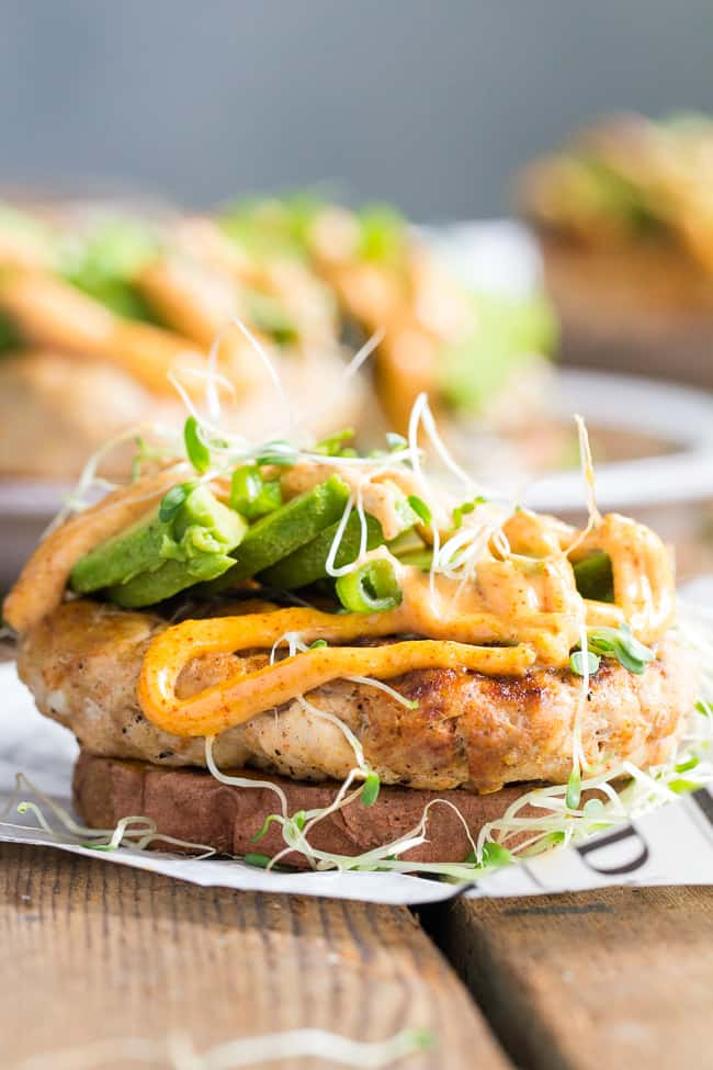 hese Chipotle Ranch Chicken Burgers are loaded with your favorite flavors and perfect on a grilled sweet potato bun!  Topped with chipotle ranch sauce, avocado and sprouts for a delicious, fun, and healthy burger that might become your new favorite!  Paleo, Whole30, gluten-free, dairy-free.