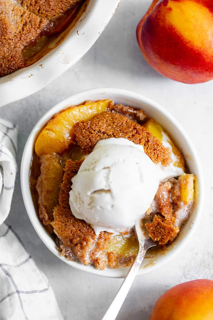 Take advantage of peach season with this paleo and vegan peach cobbler!  It's sweetened with unrefined coconut sugar and spiced with a touch of sweet cinnamon, with a warm and crisp grain-free pastry topping that's downright addicting.  A great gluten free, dairy free, egg free dessert for summer!