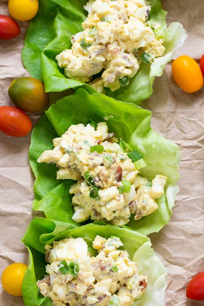 This super simple, classic paleo egg salad will become a new favorite for your whole family!  Prepared with sugar-free bacon and 1-minute homemade mayo, this egg salad is Whole30 compliant, low carb, and delicious over a green salad or in lettuce wraps!  Perfect to make ahead for weekday lunches.