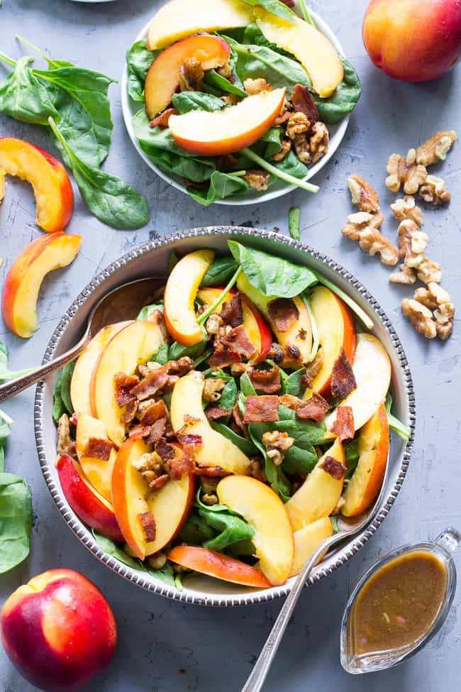 This fresh nectarine and spinach salad is loaded with so many goodies! Crispy bacon, toasted walnuts and an easy Whole30 friendly balsamic vinaigrette. You can make it a filling meal by adding grilled chicken or serve on its own. Paleo, no added sugar and Whole30 compliant.
