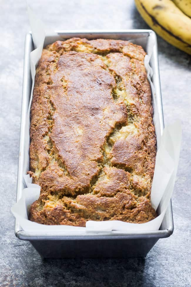 This deliciously heart yet soft and moist Paleo banana bread is made with no grains, dairy, and no added sugar. It's gluten free, Paleo and sweetened only with bananas and perfect for breakfast or a snack with your favorite spread. Kid approved and easy to make!