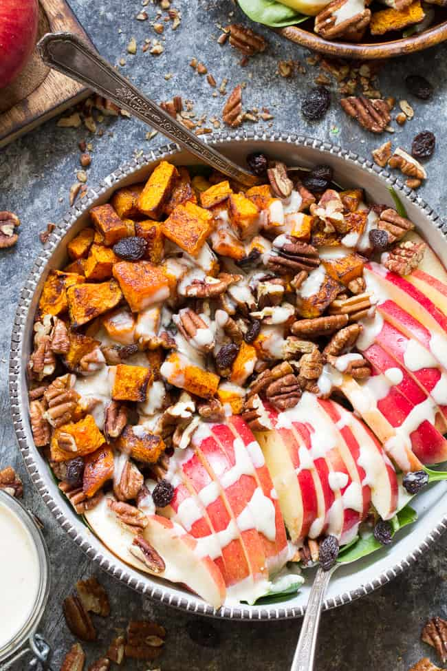 This sweet and savory roasted butternut salad is loaded with goodies! Perfectly caramelized butternut squash tossed with crisp sweet apples, pecans and raisins with a creamy homemade dairy-free buttermilk dressing using @NaturesIntentv! Paleo, vegan, and Whole30 compliant, too. #AD #NaturesIntentVinegar