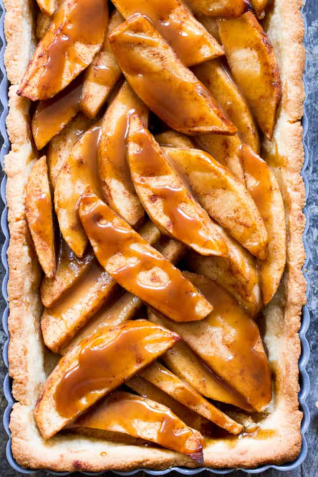 This gorgeous salted caramel apple tart is an irresistible fall dessert and easier than you think!  It begins with a buttery grain free pastry crust filled with juicy apples and topped with an easy dairy free salted caramel sauce.  Gluten free, grain free, dairy-free option, paleo, and family approved!