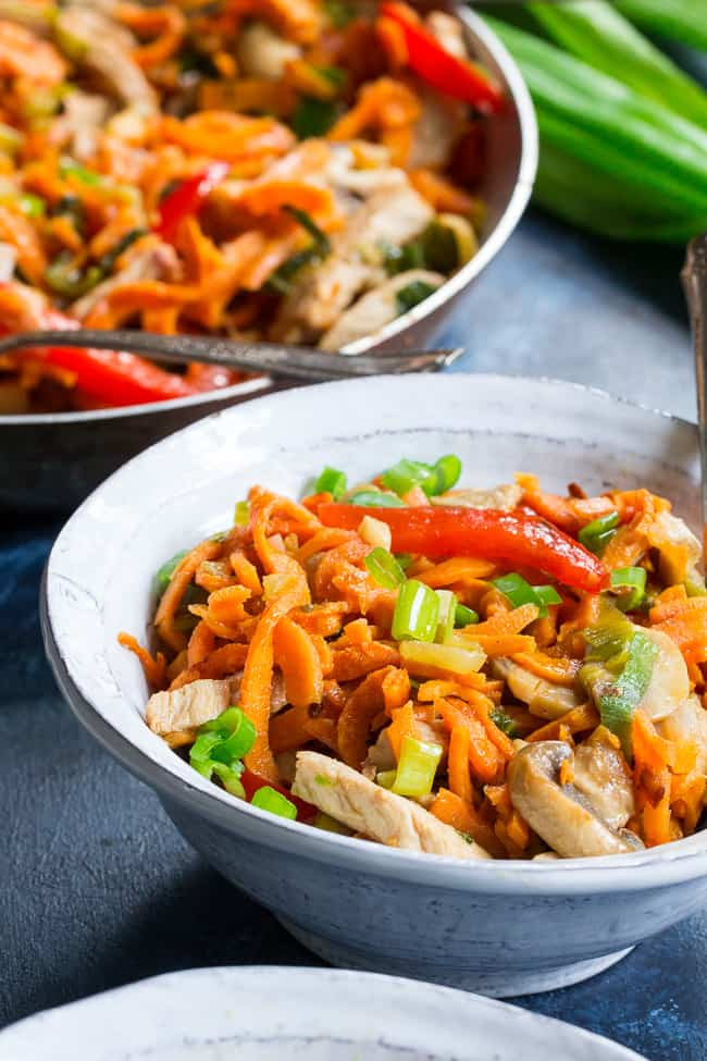 This paleo and Whole30 spin on veggie and pork lo mein uses sweet potato noodles for a delicious real-food meal packed with the traditional flavors of garlic, sesame and ginger.  High in protein, fiber, and healthy fats for a filling lunch or dinner that's grain free, soy free, gluten-free and paleo!