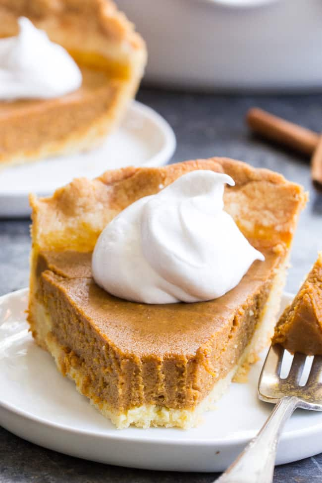 This classic Paleo Pumpkin Pie is just as delicious as any traditional pie you've made!  A buttery, flaky paleo pie crust is filled with creamy dairy free pumpkin custard and baked to perfection for a delectable holiday dessert.  Great with coconut whipped cream, gluten free, grain free, family approved!