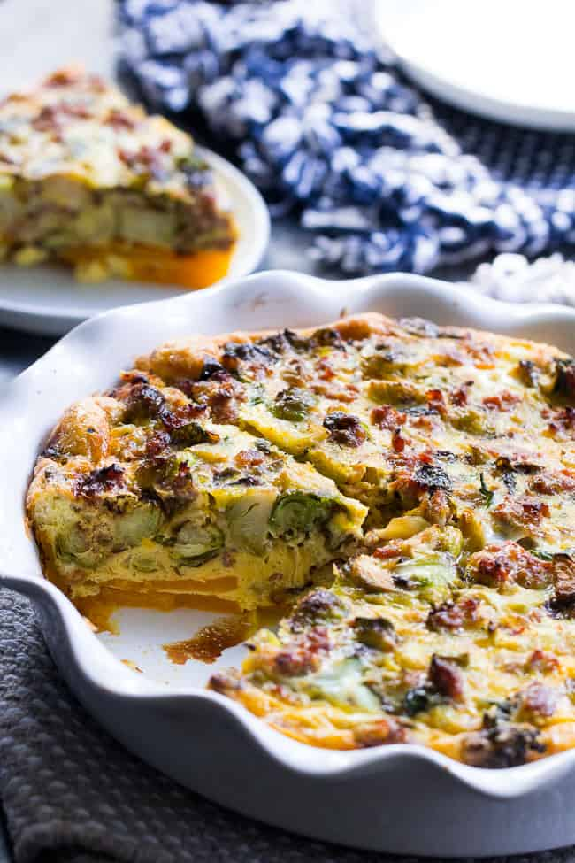 This paleo quiche has an easy butternut squash crust and is packed with sausage, veggies and tons of flavor. It's Whole30 compliant and perfect for brunch or any meal. Great as a make-ahead breakfast, too!