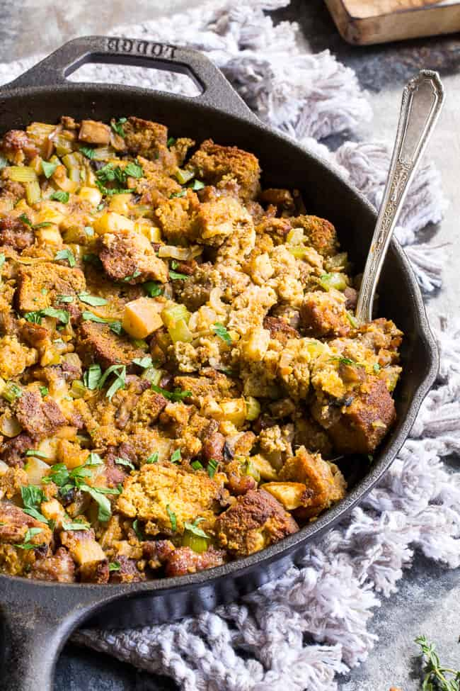 """This savory and sweet """"cornbread"""" Paleo Thanksgiving Stuffing is for all of you who want to keep with clean but still crave some bread in your stuffing! A grain-free, dairy-free sweet potato bread is cubed and baked with sausage, apples, celery and onion, mushrooms, pecans andherbs for a delicious, filling and healthy Thanksgiving stuffing reminiscent of the classic."""
