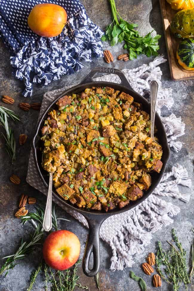 "This savory and sweet ""cornbread"" Paleo Thanksgiving Stuffing is for all of you who want to keep with clean but still crave some bread in your stuffing!  A grain-free, dairy-free sweet potato bread is cubed and baked with sausage, apples, celery and onion, mushrooms, pecans and herbs for a delicious, filling and healthy Thanksgiving stuffing reminiscent of the classic."