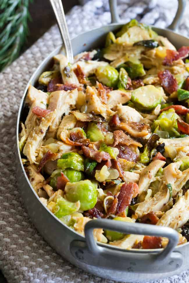 Roasted chicken and brussels sprouts are tossed with crispy bacon and baked in a creamy dairy free sauce for a super comforting, delicious and filling Whole30, paleo, and low carb meal.