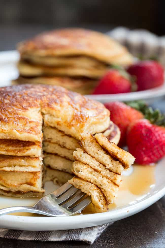 These fluffy paleo buttermilk pancakes are the perfect healthy answer to your pancake cravings! They come together quickly and are a hit with kids and adults alike. Grain free, nut free, dairy free and even freezable, which makes them great for breakfast or brunch any day of the week!