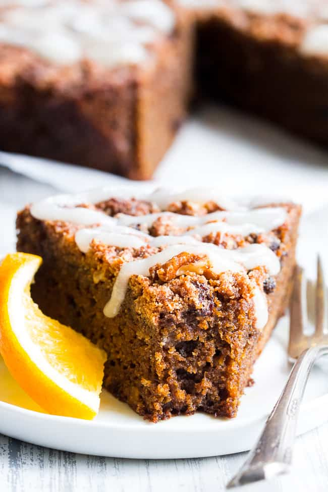 This grain free and Paleo orange gingerbread coffee cake is perfectly moist, sweet, full of sweet gingerbread spices and orange flavor.  It's topped with plenty of sweet cinnamon crumbles and an optional paleo white icing.  Perfect to serve for a holiday brunch, dessert, or anytime!