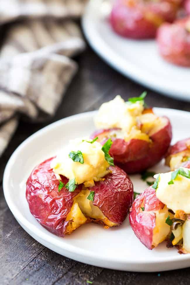 These garlic smashed potatoes are crispy on the outside, soft inside, and full of flavor! Top them or dip them in an easy 2 minute (YES!) homemade aioli that's Whole30 compliant and paleo!  Dairy free, gluten free, family approved!