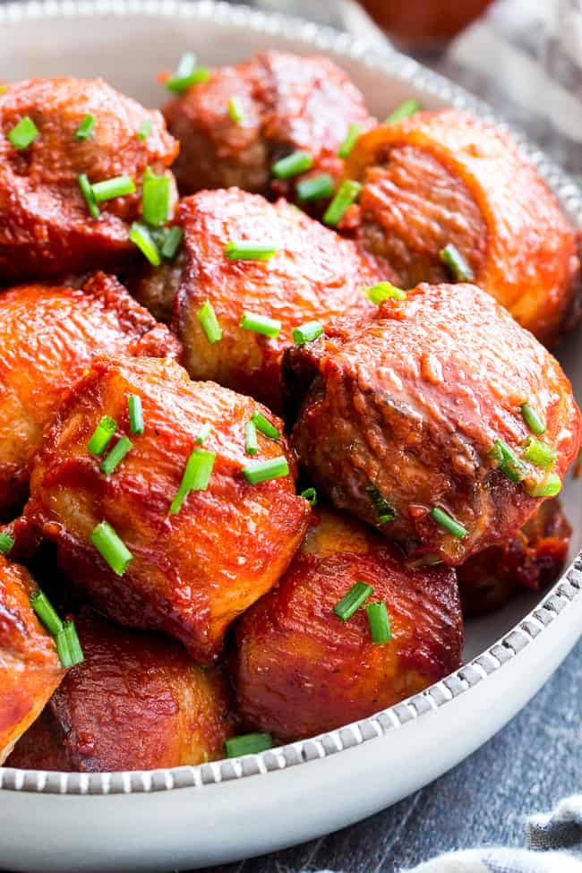 Tangy, smoky BBQ sauce and crispy bacon make these meatballs the tastiest you'll ever eat! Kid approved and made with good-for-you ingredients, these BBQ bacon wrapped meatballs are paleo, Whole30 compliant, and downright addicting!