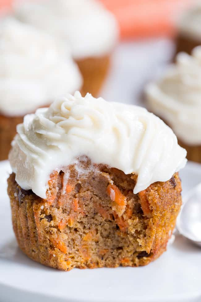 """These dreamy carrot cake cupcakes are made with coconut and tapioca flour and sweetened with maple syrup, making them both paleo and nut free.  They're topped with a sweet creamy paleo vanilla """"buttercream"""" that tastes just like real thing!"""