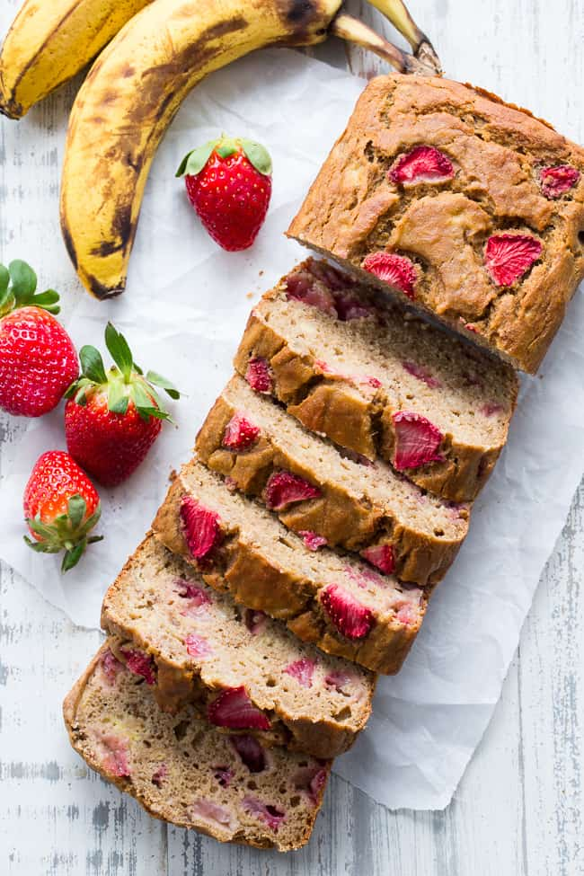 Strawberry Banana Bread that's hearty and soft with just enough sweetness, made both Paleo and nut free thanks to cassava flour!   The strawberries add sweet berry flavor without overwhelming the bread, making it perfect to go with breakfast or as a grab and go snack!  Gluten-free, dairy-free, grain free, paleo.