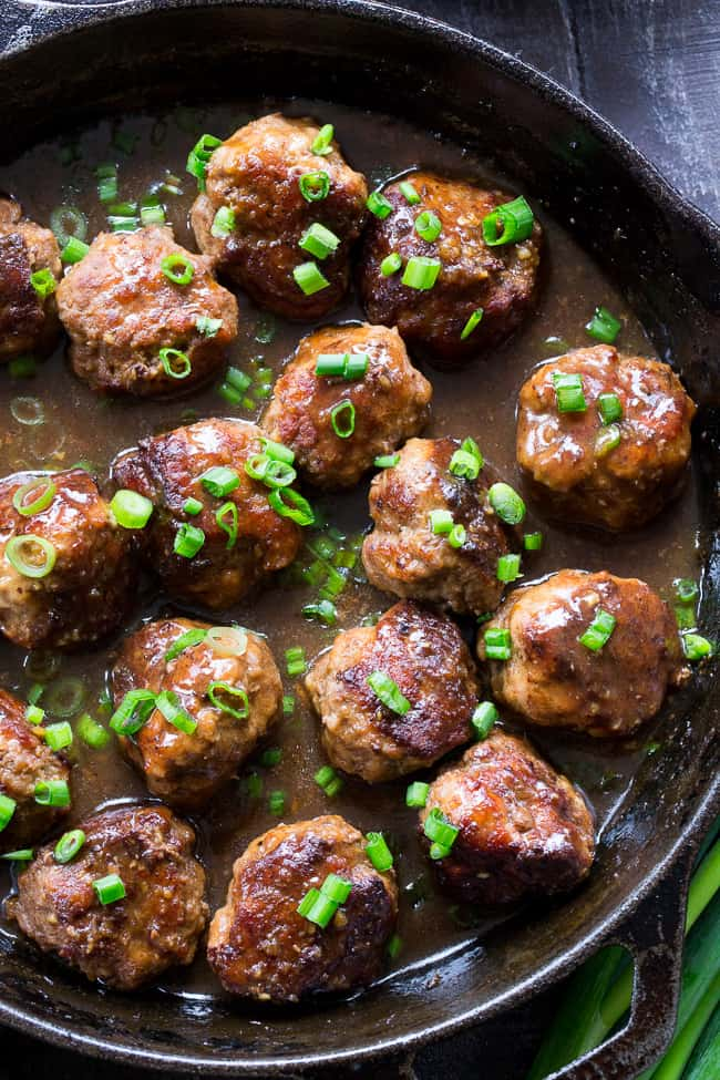 These easy one-skillet teriyaki meatballs are perfect for weeknights, packed with flavor and kid approved!  The sauce is sweetened with dates, so they're paleo and Whole30 compliant, with no added sugar.  Perfect over cauliflower rice or with a side of roasted broccoli!