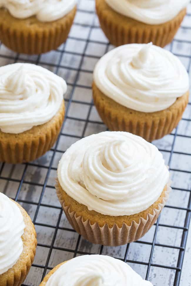 """These paleo vanilla cupcakes are so light, fluffy, moist, and sweet that you'd never guess they're gluten free, dairy free and paleo! The """"buttercream"""" frosting is easy to whip up, and tastes just like the original even though it contains no refined sugar or dairy. Kid approved and perfect for birthdays, special events, or """"just because""""!"""