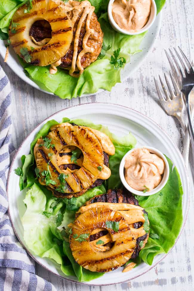 These spicy Hawaiian Chicken Burgers are super quick to make, packed with flavor and Whole30 compliant!  Serve in butter lettuce wraps topped with plenty of chipotle ranch for an easy weeknight dinner.  Perfect for grilling season or anytime!