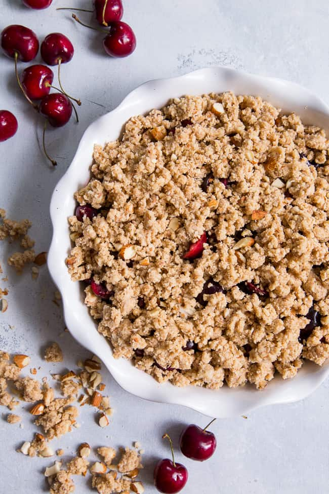 This classic cherry crisp is irresistibly delicious and easy to make!  A sweet gooey cherry filling is topped with a toasty crumble for a summer dessert that will make everyone come back for seconds.  It's paleo, vegan, gluten-free, dairy-free and refined sugar free.