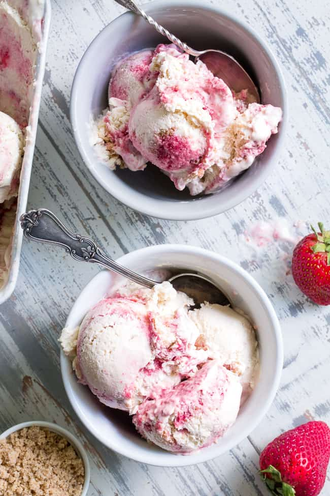 "This Strawberry Cheesecake Paleo + Vegan Ice Cream begins with a cashew-based, creamy ""cheesecake"" ice cream and swirls in strawberry puree and a grain-free graham cracker crust!  It's the perfect special treat for summer that no one will guess is actually gluten-free, dairy free, paleo and vegan!"